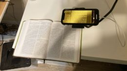 top view of a wesley study bible underneath an iphone with the magnifier active