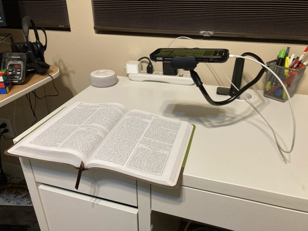 Side view of my magnifier over a copy of a Wesley Study Bible
